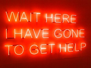 """Wait here, I have gone to get help"" in neon"